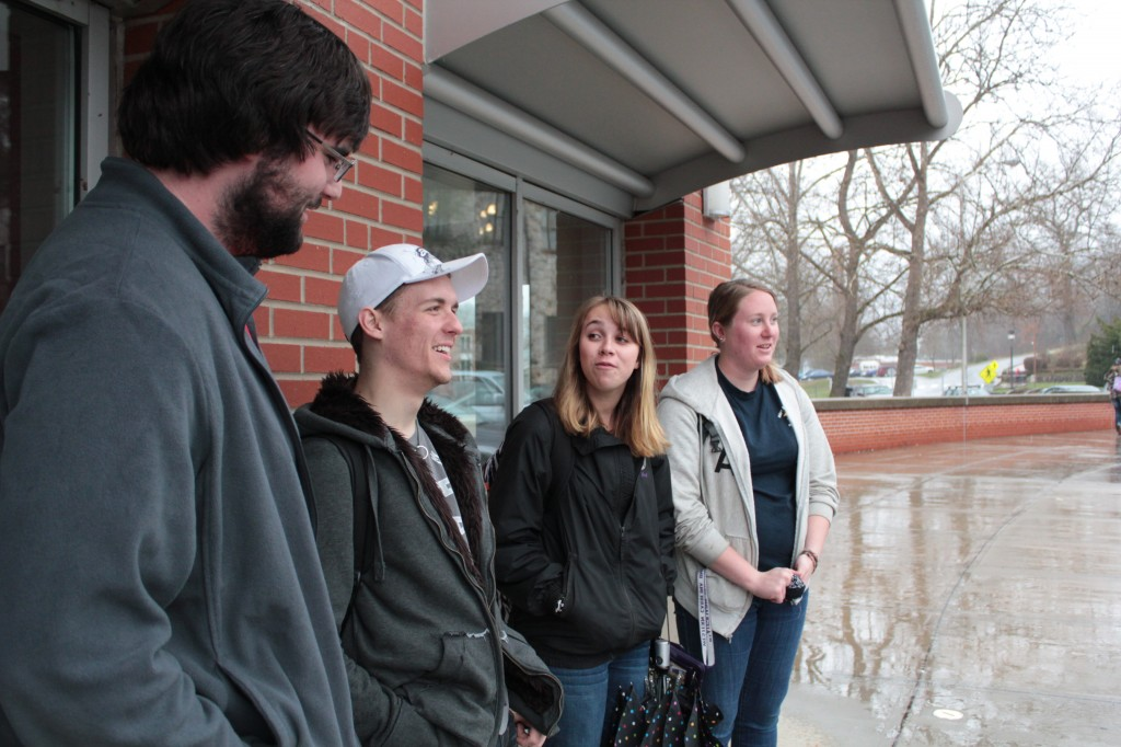 Students in the America's Wilderness Ethics and Aesthetics class wait on the van to arrive.  Photo by Brandy Carl