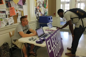 Student Devin Mitchell casting his vote for SGA elections