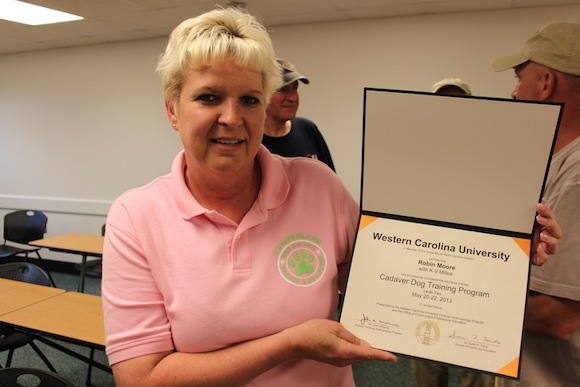 Robin Moore smiles with her certificate after completing the level two cadaver dog training program at WCU. Photo by Ben Haines.