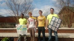 EcoCats members look for students to sign their petition to make Duke Energy use more renewable energy. Photo by Ceillie