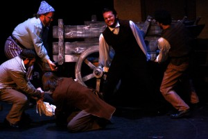 Jean Valjean saves a man's life by lifting a fallen wagon off of him. Photo by Ceillie Simkiss