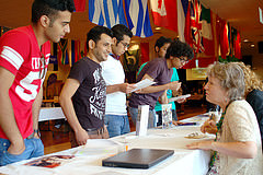 IEP students talking to one of their instructors at the Study Abroad Fair. Photo: Hilary Lindler