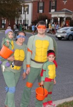 A family dressed as Teenage Mutant Ninja Turtles getting ready to trick or treat. This is their third year as they come to the event. Photo by Temi-Tope Adeleye.