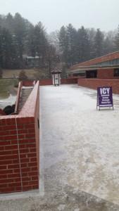 Hazardous ice glazed sidewalks.