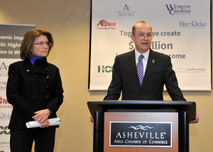 UNCA Chancellor Mary Grant  and WCU Chancellor David Belcher, as he  speaks on higher education impact on state's economy.