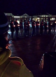 Students and faculty gather for a candlelight vigil for the loss of three UNC-Chapel Hill students.