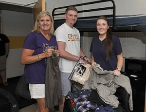 From left, Deannie Starnes and her son, Carter, and daughter, Allie, begin unpacking Carter's belongings in his room at Scott Residence Hall. Photo courtesy of WCU Office of Public Relations.