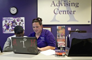 Anna Thompson, the administrative support specialist in WCU's Advising Center, helps student Amarillis Harper look for classes on Advising Day. Photo by Shelby LeQuire, Oct. 27, 2015.