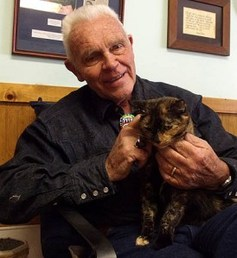 "Harold ""Catman"" Sims, owner of Catman2, loves on a kitty. Photo via catman2.org"