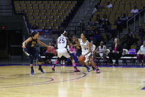 WCU Starting Forward, Erika Joseph sets a screen for Raziyah Farrington to make her way to the basket. Photo By Calvin Inman.