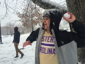 Jackson Norton plays in a snowball fight. Photo by Bradley Lucore.