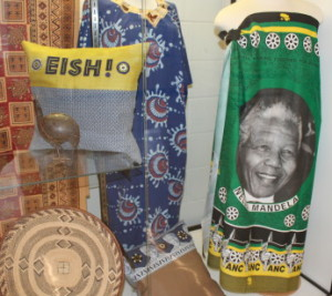 A few of the items loaned to the exhibit by Katy Ginanni. Her favorite piece is the Nelson Mandela fabric on the right.