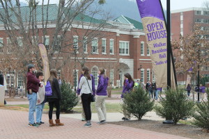 Open house participants wait for a tour of Walker residence hall. Photo by Haley Smith.