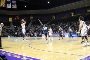Catamount guard, Devin Peterson attempts a 3 point shot, Feb. 11, 2016. Photo by Chad Grant.