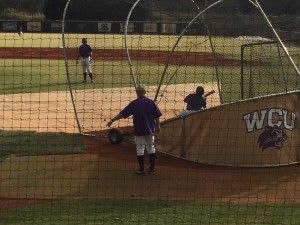 Coach Guilliams coaching Senior Danny Bermudez in the batting cage. Photo by David Johnson.