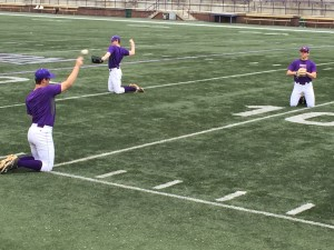 Baseball pitchers warming up in split practice at the football field, Jan. 29 2016. Photo by David Johnson.