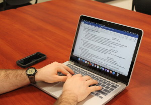 WCU student, Bradley Lucore, working on his resume. Photo by Haley Smith.
