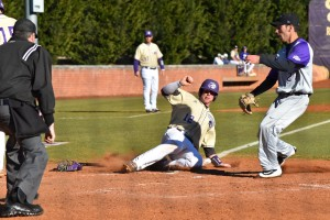 Bryson Bowman slides into home plate. Photo by Becca Ross.