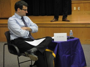 Todd Collins keeps track of the time while panelists talk. Photo by Shelby LeQuire.