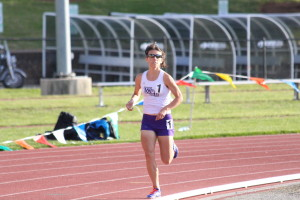 WCU distance runner, Laney Browder in the bend of the track in the 10000 meter race. Photo by Calvin Inman.
