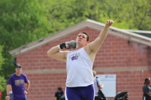 Scott Peretin throwing in the shot put. Photo by Calvin Inman.