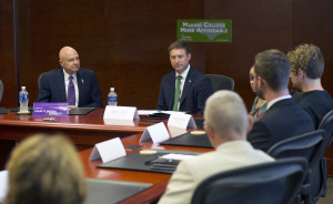 Western Carolina University Chancellor David O. Belcher (left) and Andrew Heath, state budget director, discuss college affordability and related issues with WCU students. Photo by WCU Public Relations Office.