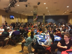 UC Illusions filled with over 100 students joined together to take in the record-breaking presidential debate. Photo by: Ashley Kairis