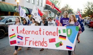 WCU international students march down Main Street in Sylva during the 2015 Homecoming parade. Photo from WCU News.