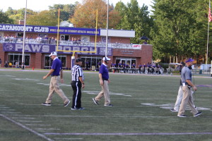 WCU Coach Speir walking toward midfield during a timeout. Photo by Marcus Smith.