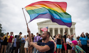 "As the crowd outside of the Supreme Court chanted, ""Love Has Won,"" in June of 2015, supporter Vin Testa celebrated with the waving of a rainbow flag. Photo courtesy of the New York Times"
