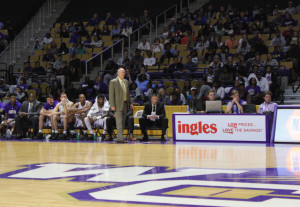 Coach Hunter standing court side. Photo by Marcus Smith.