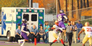Trey Morgan in mid-air ripping down an interception that would seal the win. Photo by Calvin Inman.