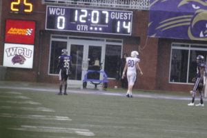 Slippery when wet: Catamounts fall to Paladins on Homecoming